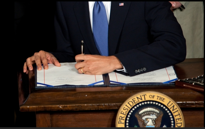 Obama Signing Affordable Care Act Into Law